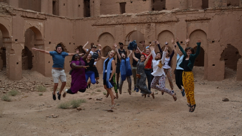 Students jump among ruins in Morocco.