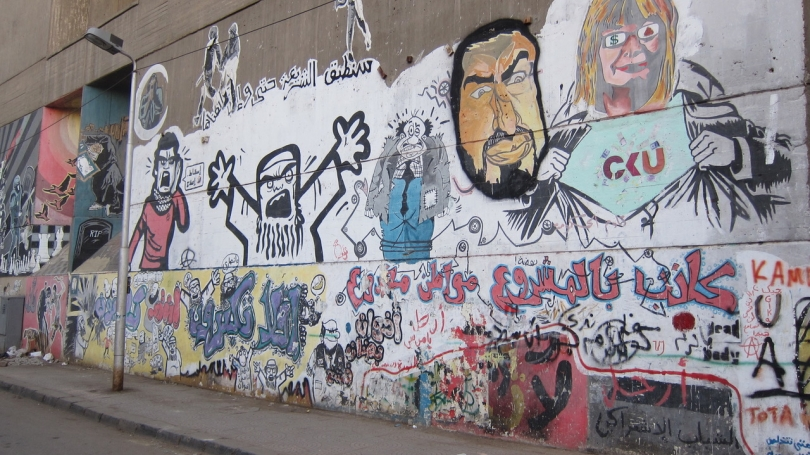 A graffiti mural on a wall.